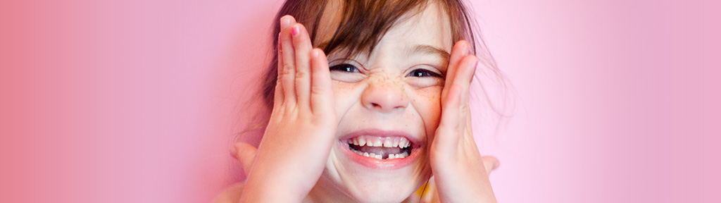 little girl smiling with a tooth gap