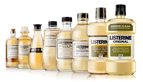 Listerine old fashion product bottles line up