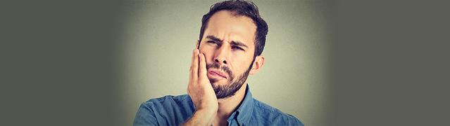 man looking concerned about tooth decay