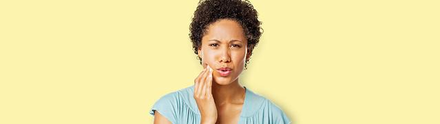 woman looking concerned about gum disease and gingivitis