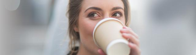 Listerine's on the go causes of bad breath - woman drinking coffee