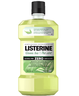 Listerine Essential Oils with Green Tea Flavour bottle against green background