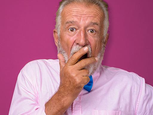 older man looking surprised finding out about gum disease