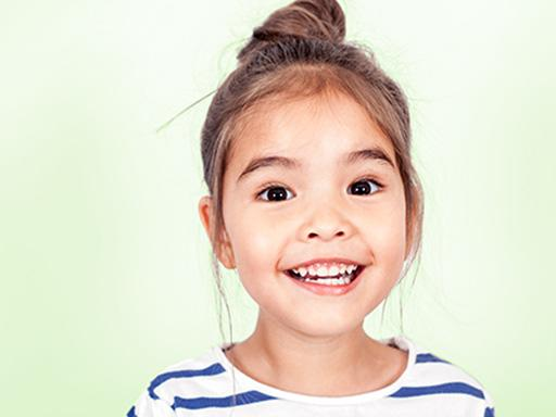 little girl with a striped shirt smiling