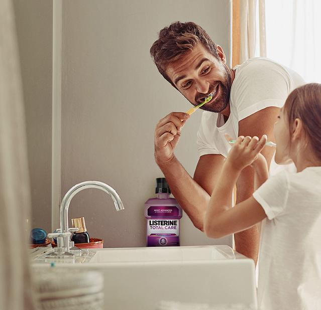 Father and daughter oral healthcare routine with Listerine