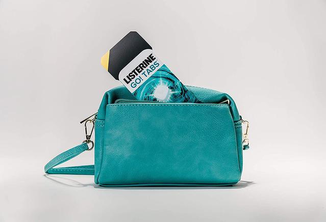 Package of Listerine Go! Tabs inside a light blue purse