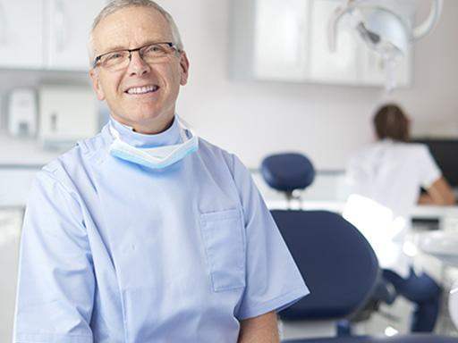 dentist smiling in a dental office